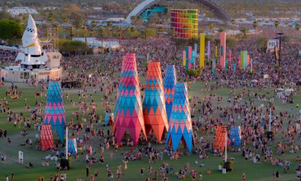 aerial shot of coachella's sahara tent stage with three interactive art installations